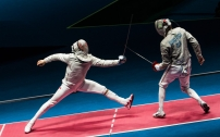 Canada's Joseph Polossifakis competes with Aliaksandr Buikevich of Belarus in their Men's Sabre Individual Table of 32 fencing match.