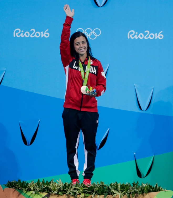 Meaghan Benfeito stands on the podium
