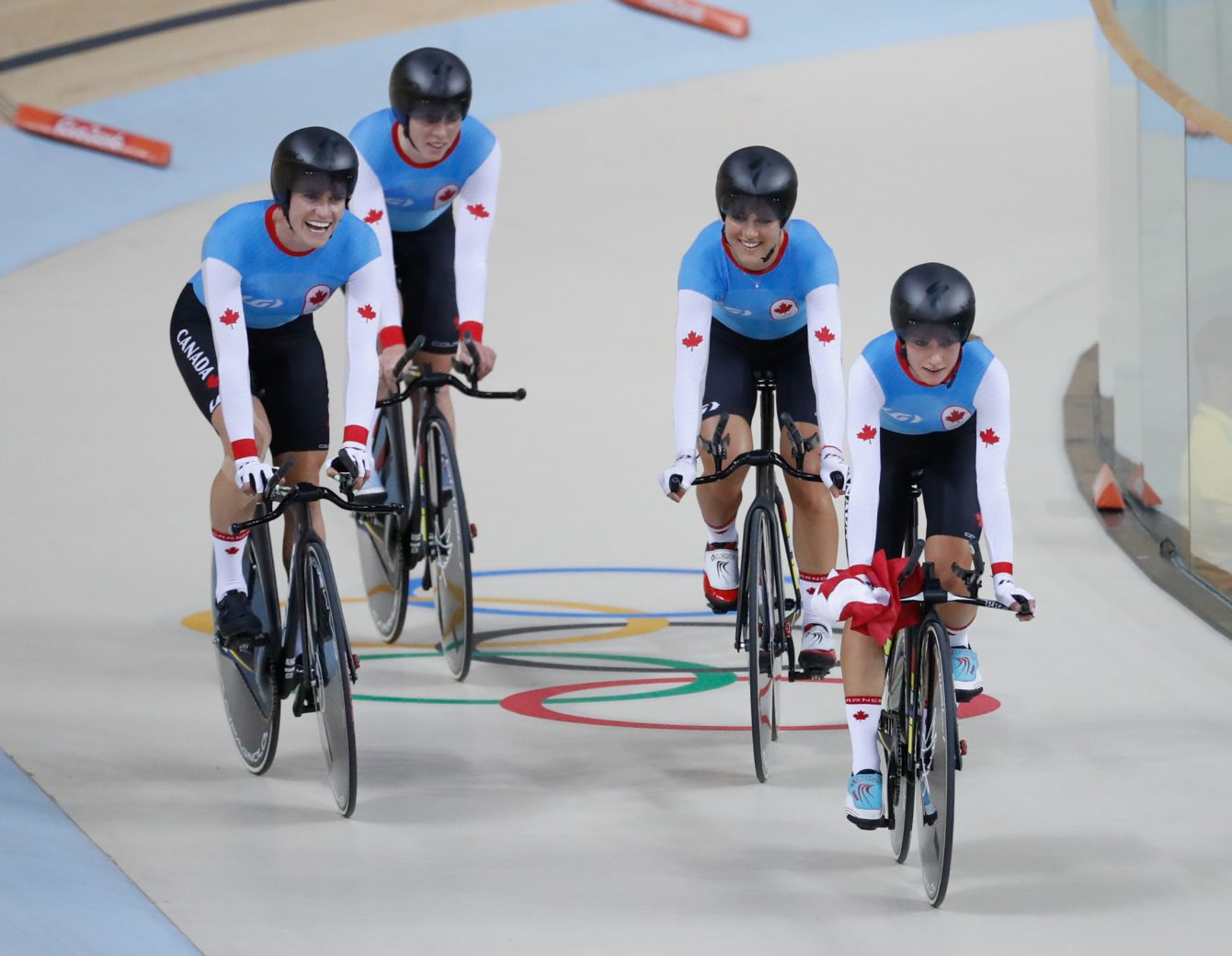 Canada's women's team pursuit team Allison Beveridge, Jasmin Glaesser, Kirsti Lay, and Georgia Simmerling race after winning the bronze medal at the velodrome at the Olympic games in Rio de Janeiro, Brazil, Saturday August 13, 2016. (photo/ Mark Blinch)