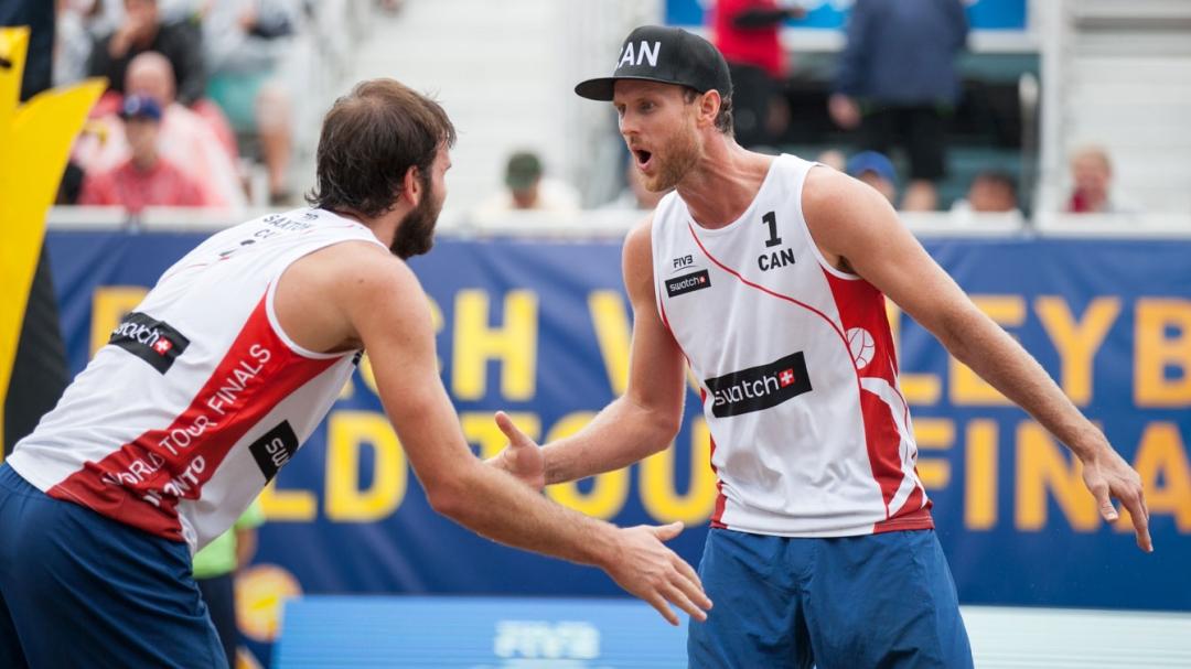 Ben Saxton and Chaim Schalk celebrate beating The Netherlands in the quarterfinals of the FIVB World Tour Finals