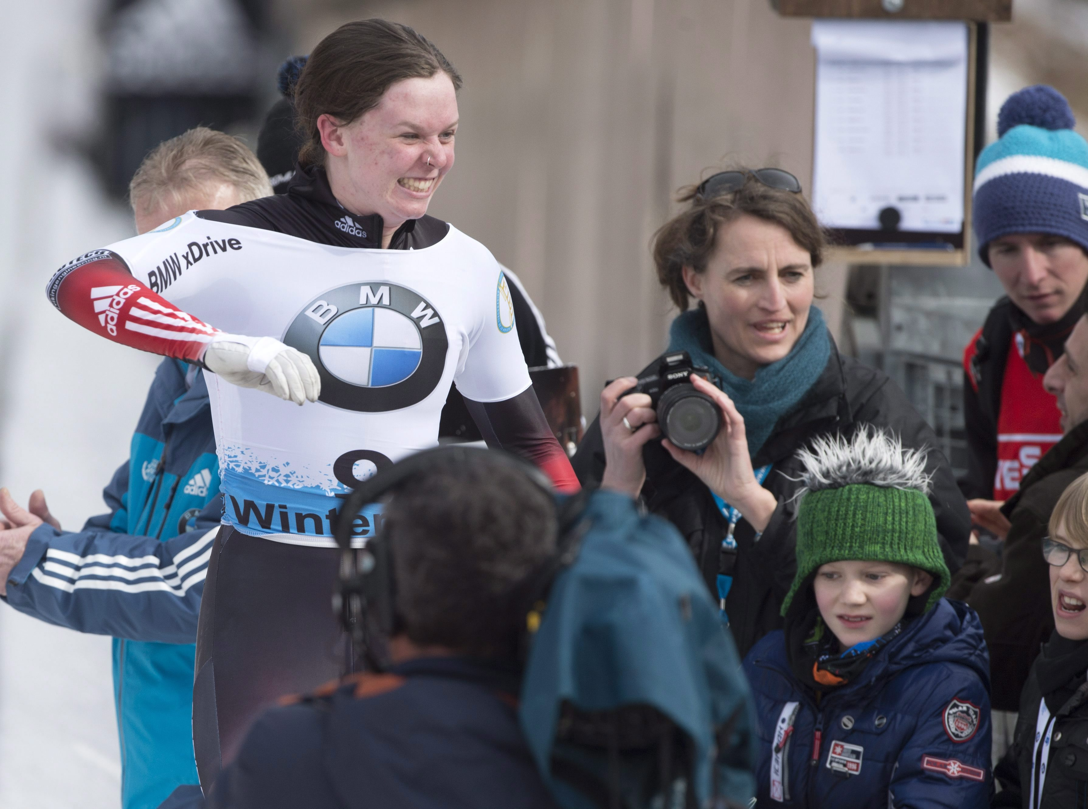 Bronze medallist Elisabeth Vathje of Canada, left, celebrates after the women's skeleton race at the Bobsleigh and Skeleton World Championships in Winterberg, Germany, Saturday, March 7, 2015. (AP Photo/Jens Meyer)
