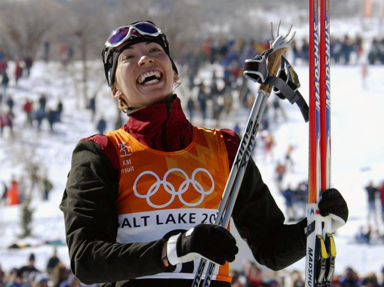 Canada's Beckie Scott, of Vermilion, Alta., celebrates after tying for the bronze medal in the women's cross-country pursuit at the Winter Olympics Friday, Feb. 15, 2002, at Soldier Hollow in Midway, Utah. (AP Photo/Andrew Medichini)
