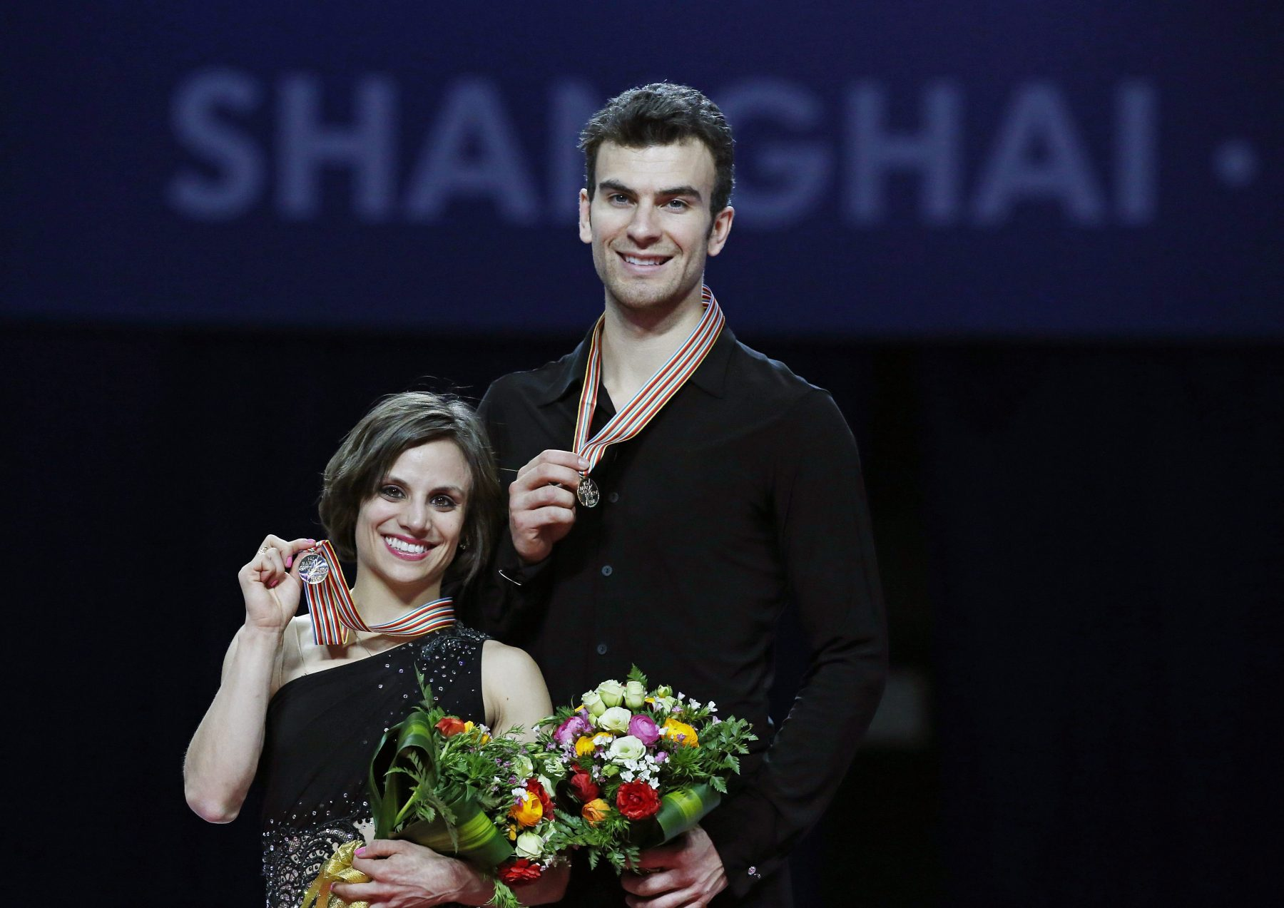 Meagan Duhamel and Eric Radford with their gold medals from the 2015 World Championships