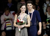 Canada's Tessa Virtue and Scott Moir stand on the podium with their gold medals during the 2016 Skate Canada International competition in Mississauga, Ont., on Saturday, October 29, 2016. THE CANADIAN PRESS/Mark Blinch