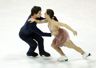 Tessa Virtue and Scott Moir of Canada compete in the Ice Dance Free Dance Program during ISU Grand Prix of Figure Skating Final in Marseille, southern France, Saturday, Dec. 10, 2016. (AP Photo/Christophe Ena)