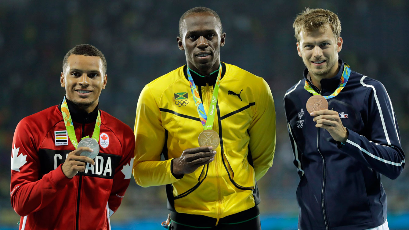 Andre De Grasse stands on men's 200m podium at Rio 2016 after winning silver. (AP Photo/Jae C. Hong)
