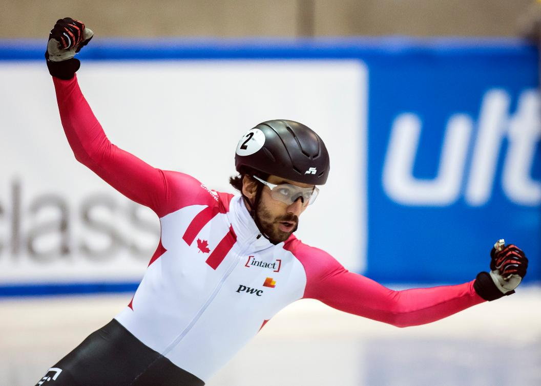 Team Canada - Winner Charles Hamelin of Canada celebrates winning the men's 1500m at the short track speed skating World Cup in Dresden, Germany, Saturday, Feb. 4, 2017. (AP Photo/Jens Meyer)