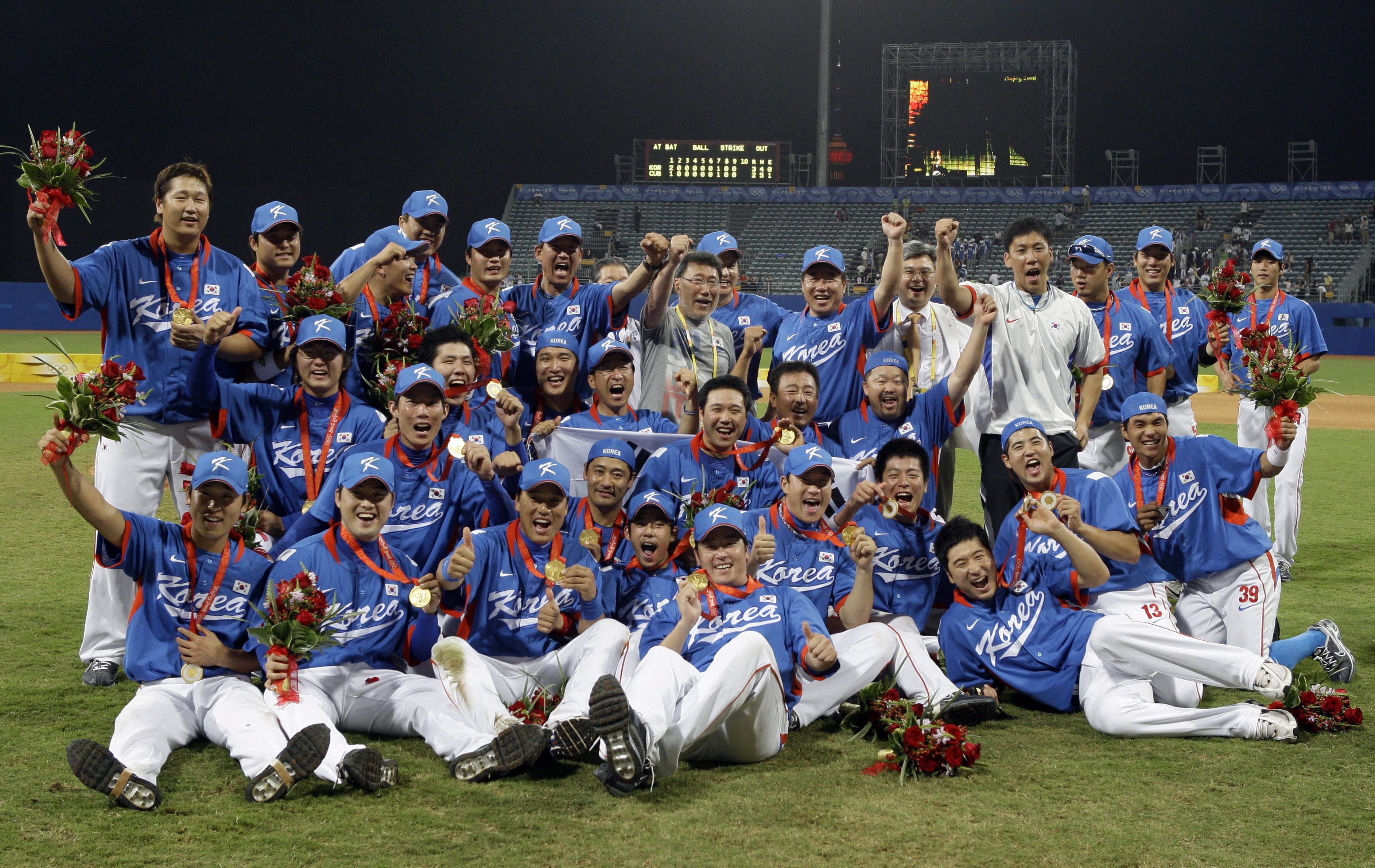 South Korea players celebrate with their gold medals after beating Cuba 3-2 in the gold medal baseball game at the Beijing 2008 Olympics in Beijing, Saturday, Aug. 23, 2008. (AP Photo/Kathy Willens)