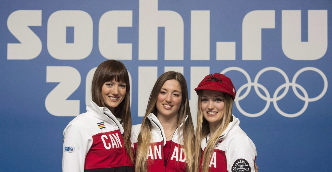 Dufour-Lapointe sisters smiling at Sochi 2014 Olympics