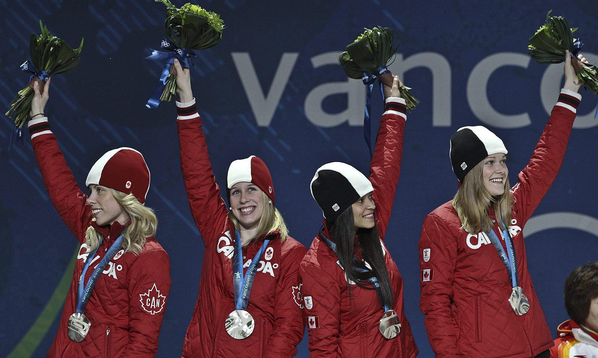 Short track medallists on the podium