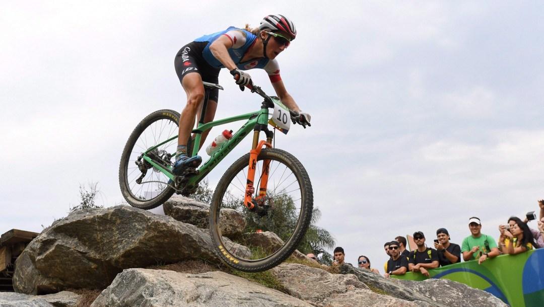 Mountain biker going over rock