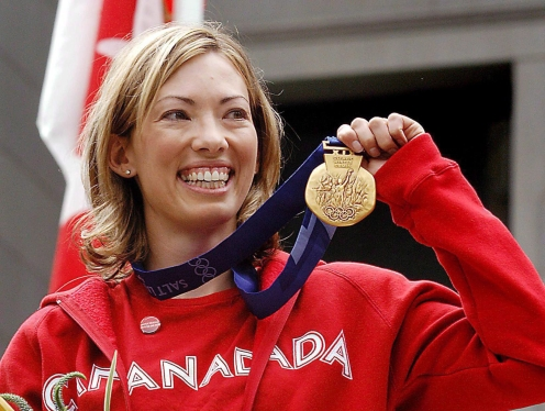 Canadian cross-country skier Beckie Scott displays her gold medal she was awarded at a ceremony in Vancouver, Friday, June 25, 2004. THE CANADIAN PRESS/Chris Bolin