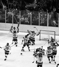 In this Feb. 22, 1980, file photo, the United States ice hockey team rushes toward goalie Jim Craig after their 4-3 upset win over the Soviet Union in the semi-final round of the XIII Winter Olympic Games in Lake Placid, N.Y. (AP Photo/File)