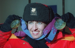 Canada's Myriam Bedard shows off her two gold medals following the medal ceremony in Lillehammer Wednesday for the Olympic women's 7.5km biathlon. Bedard also won the gold in the 15km event. (CP PHOTO) 1994 (stf-Ron Poling)