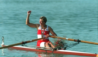 Silken in boat smiling with fist in the air