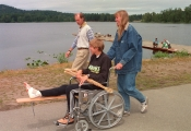 Canadian rowing team member Silken Laumann, accompanied by team doctor Richard Backus and her sister Daniele Laumann Hart. Silken Laumann was visiting the Victoria City Rowing club Tuesday June 9, 1992. In the background Laumann's scull is being adjusted by technicians. (CP PHOTO/Bruce Stotesbury)