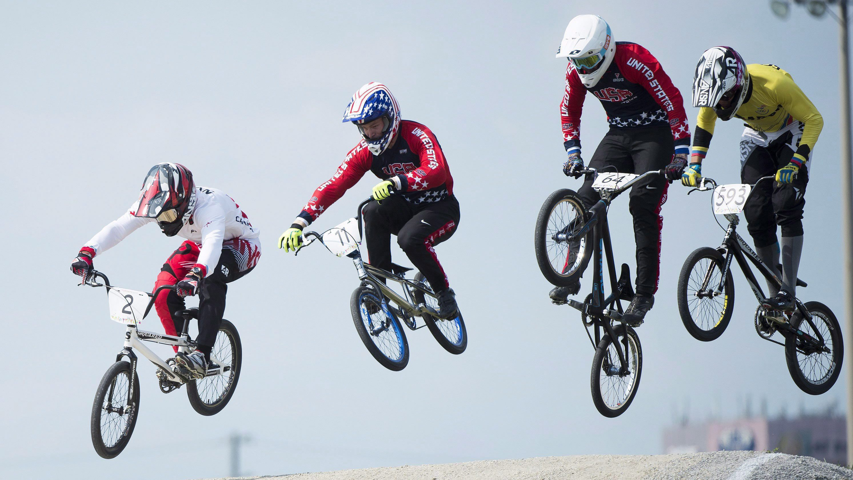 Canadian Tory Nyhaug, left, leads the pack over a jump during men's BMX finals at the Pan American Games in Toronto on Saturday, July 11, 2015. Nyhaug went on the win gold.