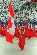 Brian Orser carries Canadian flag into Calgary 1988 Opening Ceremony