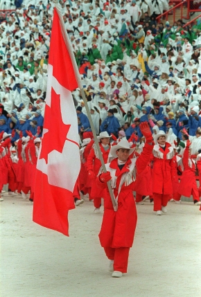 World figure skating champion Brian Orser carries the Canadian flag as he leads the Canadian Olympic team into McMahon Stadium in Calgary during the opening ceremony of the XV Olympic Winter Games on February 13, 1988. THE CANADIAN PRESS/Paul Chiasson