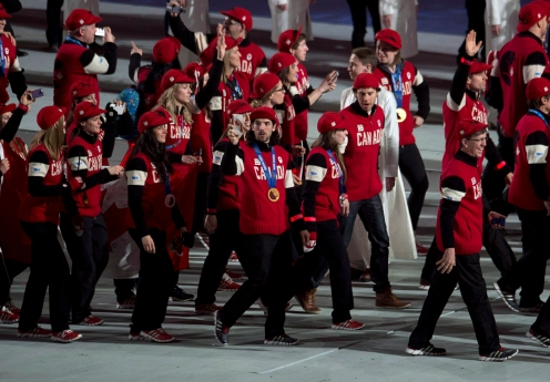 Members of the Canadian team enter the stadium for the closing ceremony for the Sochi 2014 Olympic Winter Games Sunday February 23, 2014 in Sochi, Russia. THE CANADIAN PRESS/Adrian Wyld