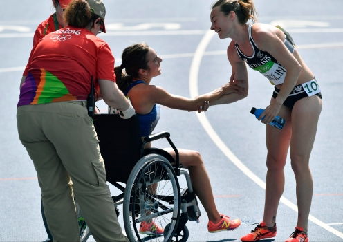 New Zealand's Nikki Hamblin greets United States' Abbey D'Agostino, left, as she is helped from the track after competing in a women's 5000-meter heat during the athletics competitions of the 2016 Summer Olympics at the Olympic stadium in Rio de Janeiro, Brazil, Tuesday, Aug. 16, 2016. (AP Photo/Martin Meissner)