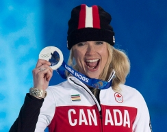 Canada's Dominique Maltais holds up her silver medal for Ladies' Snowboard Cross during the medal ceremony at the Sochi 2014 Olympic Winter Games Sunday February 16, 2014 in Sochi, Russia. THE CANADIAN PRESS/Adrian Wyld