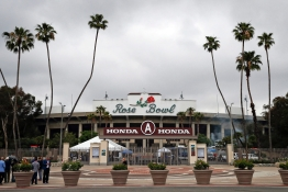 Members of the media gather outside the Rose Bowl Stadium, a proposed Olympic venue, Wednesday, May 10, 2017, in Pasadena, California. (AP Photo/Jae C. Hong)