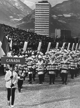 Athletes representing Canada in the 1968 Olympic Winter Games take part in the opening ceremony in Grenoble, Feb. 6, 1968. (AP Photo)