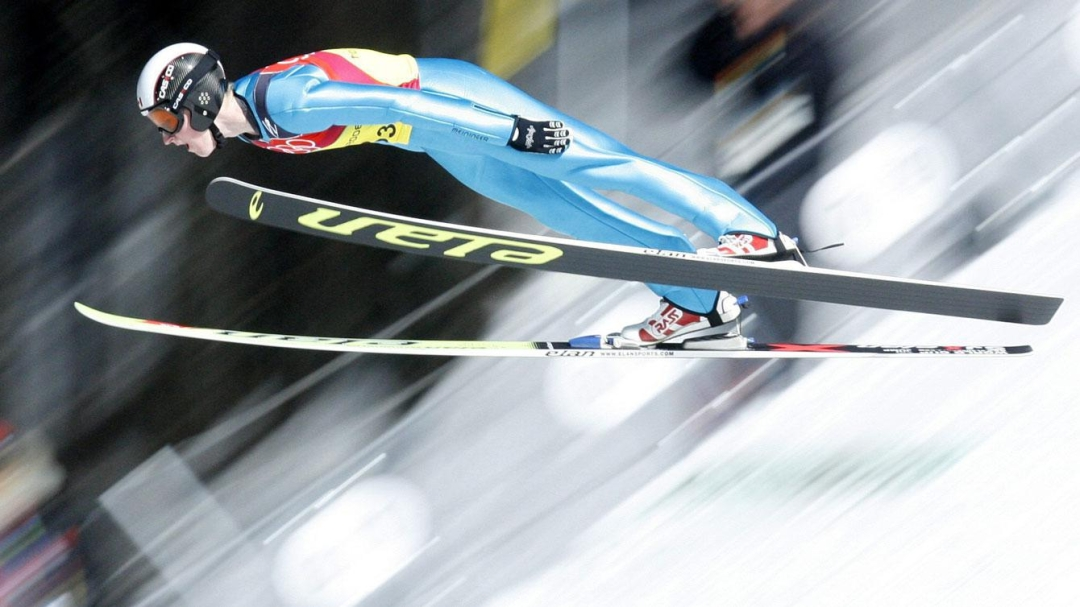 Team Canada - Graeme Gorham jumps during the team competition at the Turin 2006 Winter Olympic Games