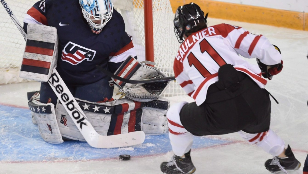 United States goalie Alex Rigsby makes a save on a shot by Canada's Jillian Saulnier