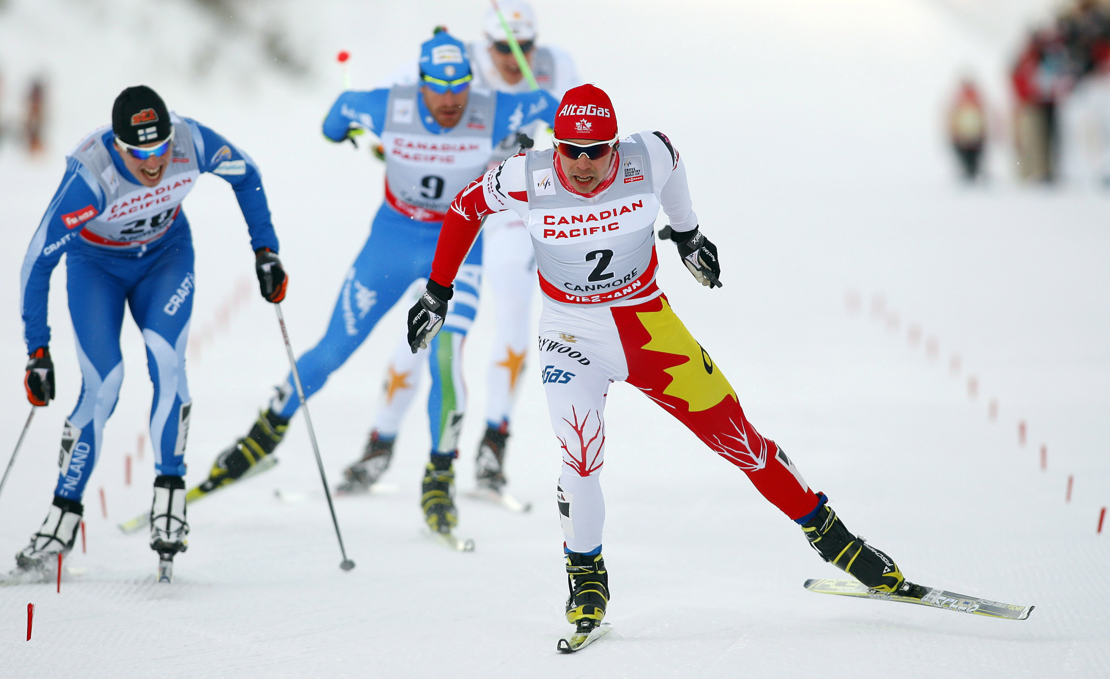 Jesse Cockney skiing with competitors trailing behind him