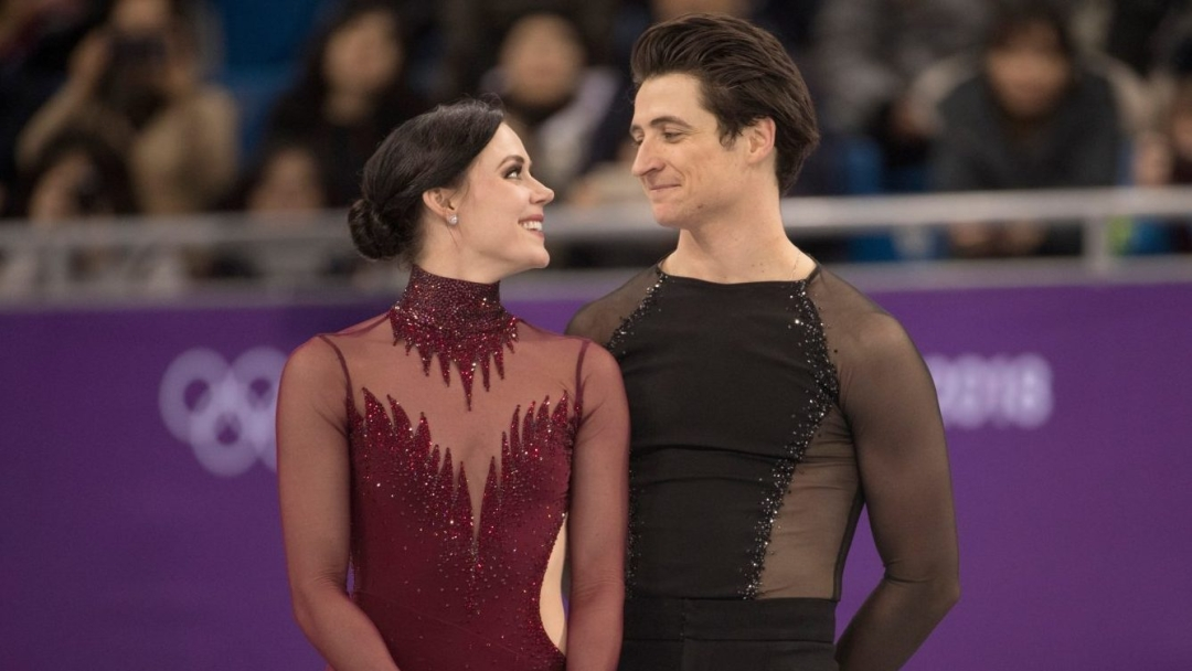 Scott and Tessa close looking at each other smiling