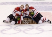 Haley Irwin and teammate Cherie Piper pose with their gold medals