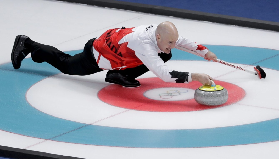 Kevin Koe throws a stone