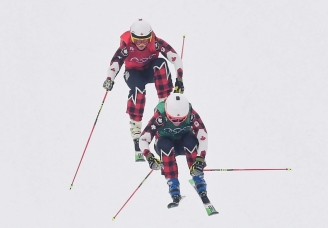 Canadians Kelsey Serwa, top, and Brittany Phelan compete in the women's ski cross semifinal at the Phoenix Snow Park at the 2018 Winter Olympic Games in Pyeongchang, South Korea, Friday, Feb. 23, 2018. THE CANADIAN PRESS/Jonathan Hayward