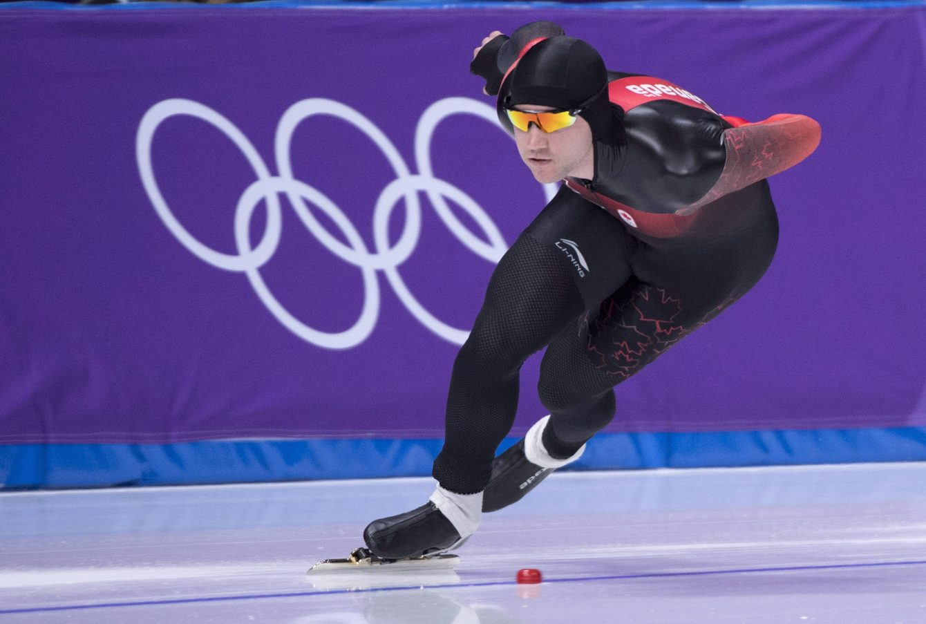 Vincent De Haitre skates in front of Olympic rings