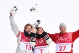 Gold medallist Sebastien Toutant of Canada, centre, silver medallist Kyle Mack of the United States, left, and bronze medallist Billy Morgan of Great Britain celebrate following the men's snowboard big air final at the 2018 Winter Olympic Games in Pyeongchang, South Korea, Saturday, Feb. 24, 2018. THE CANADIAN PRESS/Jonathan Hayward