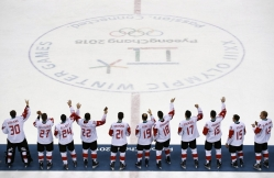 Canada hockey team celebrate with their bronze medals after beating the Czech Republic in the men's bronze medal hockey game at the 2018 Winter Olympics in Gangneung, South Korea, Saturday, Feb. 24, 2018. (AP Photo/Charlie Riedel)