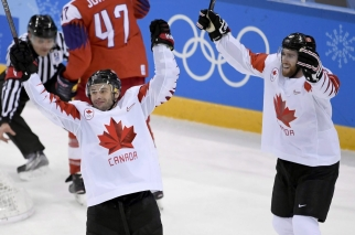 SATURDAY OLYMPIC REPEATS Canada forward Wojciech Wolski (8) celebrates his goal with teammate Quinton Howden (16) during third period men's hockey bronze medal game action against Czech Republic at the 2018 Olympic Winter Games, in Pyeongchang, South Korea, on Saturday, February 24, 2018. THE CANADIAN PRESS/Nathan Denette