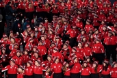 Canadian athletes enter the stadium during the closing ceremonies at the 2018 Pyeongchang Olympic Winter Games in Pyeongchang, South Korea, while drones design the Games' mascot in the sky on Sunday, February 25, 2018. THE CANADIAN PRESS/Paul Chiasson
