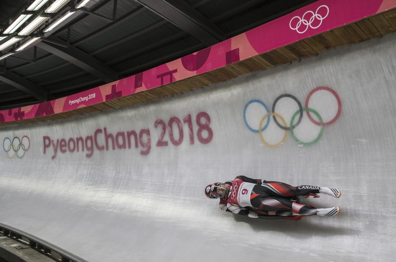 Tristan Walker and Justin Snith compete in the men's Luge doubles