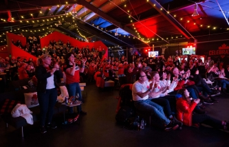 People gather at Canada Olympic House to watch the opening ceremony