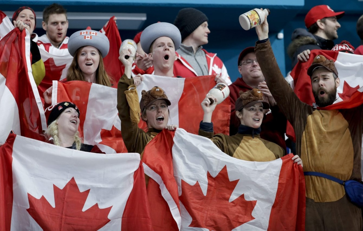 Canada's fans celebrate winning gold at the end of a mixed doubles final curling match against Switzerland at PyeongChang 2018