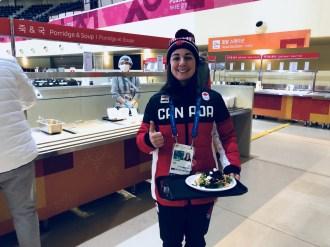 Moguls skier Andi Naude grabs food in the Athletes Village