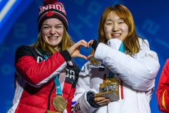 Kim Boutin of Canada receives the bronze medal for finishing in 3rd position in the Short Track Speed Skating Women's 1500m final at the PyeongChang Olympic Plaza during the PyeonChang Olympic Winter Games in PyeongChang, South Korea on February 18, 2018. (Photo by Vincent Ethier/COC)