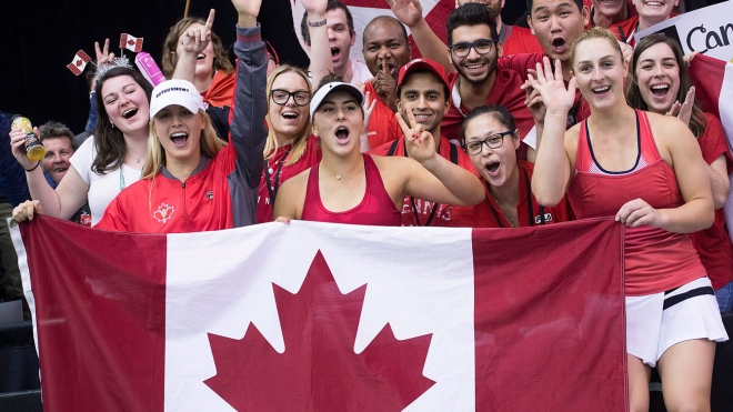 Genie Bouchard,Gaby Dabrowski and Bianca Andreescu celebrate after defeating Ukraine