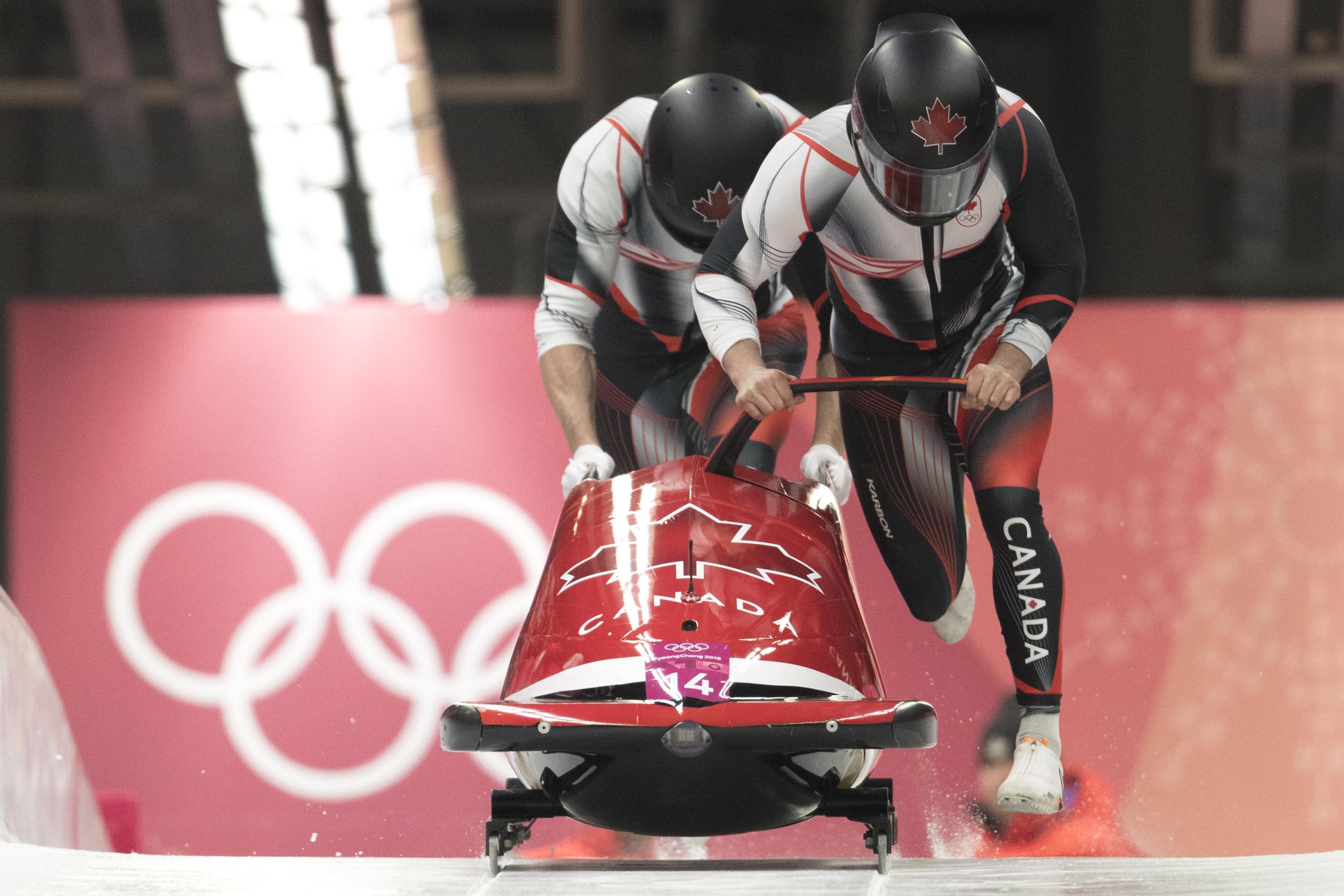 Bobsledders push two-man sled