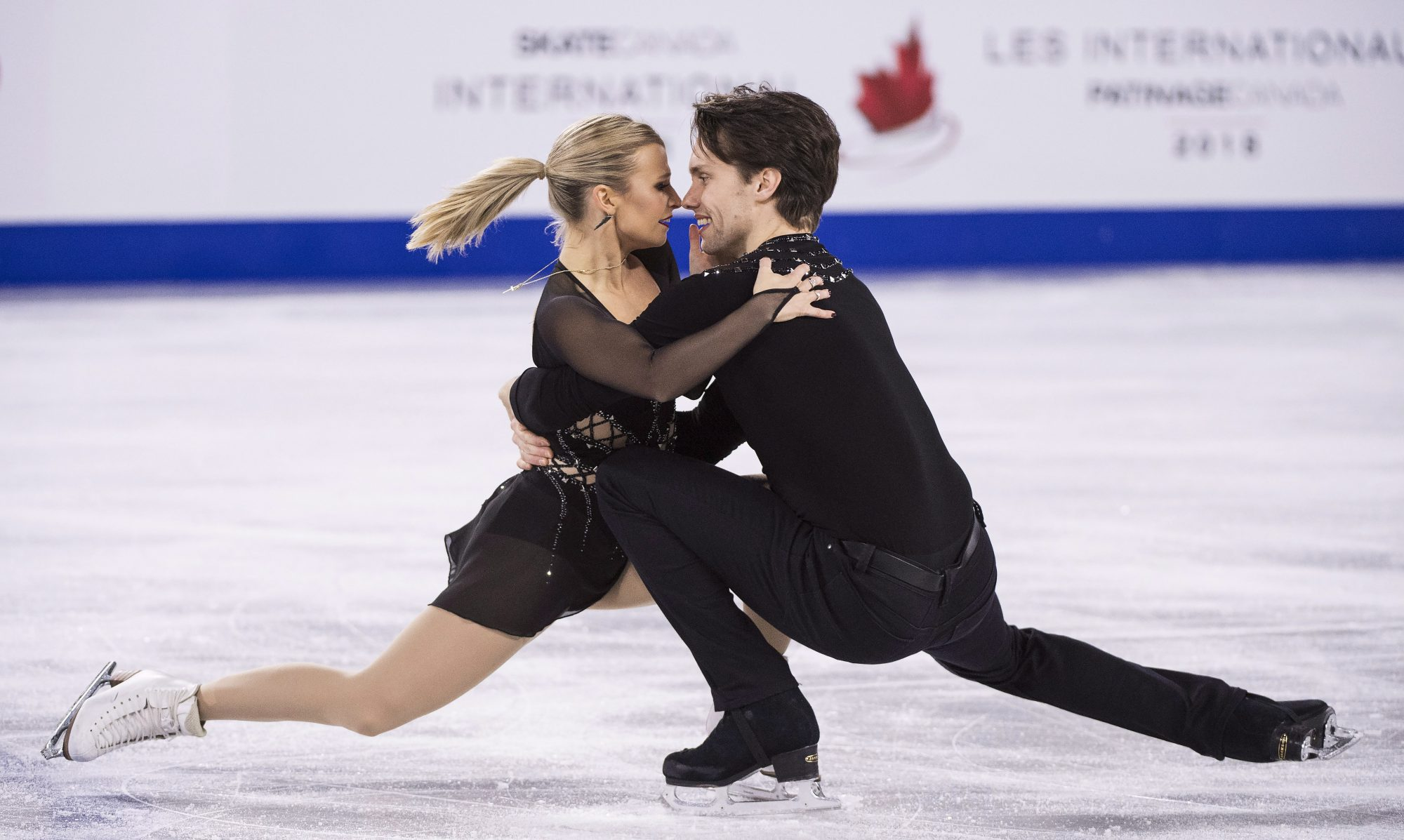 Kirsten Moore-Towers and Michael Marinaro perform a pair spin