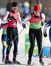 Beckie Scott (right) of Vermillion, Alberta skiis away after being tagged by Sara Renner (left) of Canmore, Alberta in women's team sprint cross-country skiing competition at the Olympic Games in Pragaleto Plan, Italy on Tuesday, February 14, 2006.(CP PHOTO/Frank Gunn)