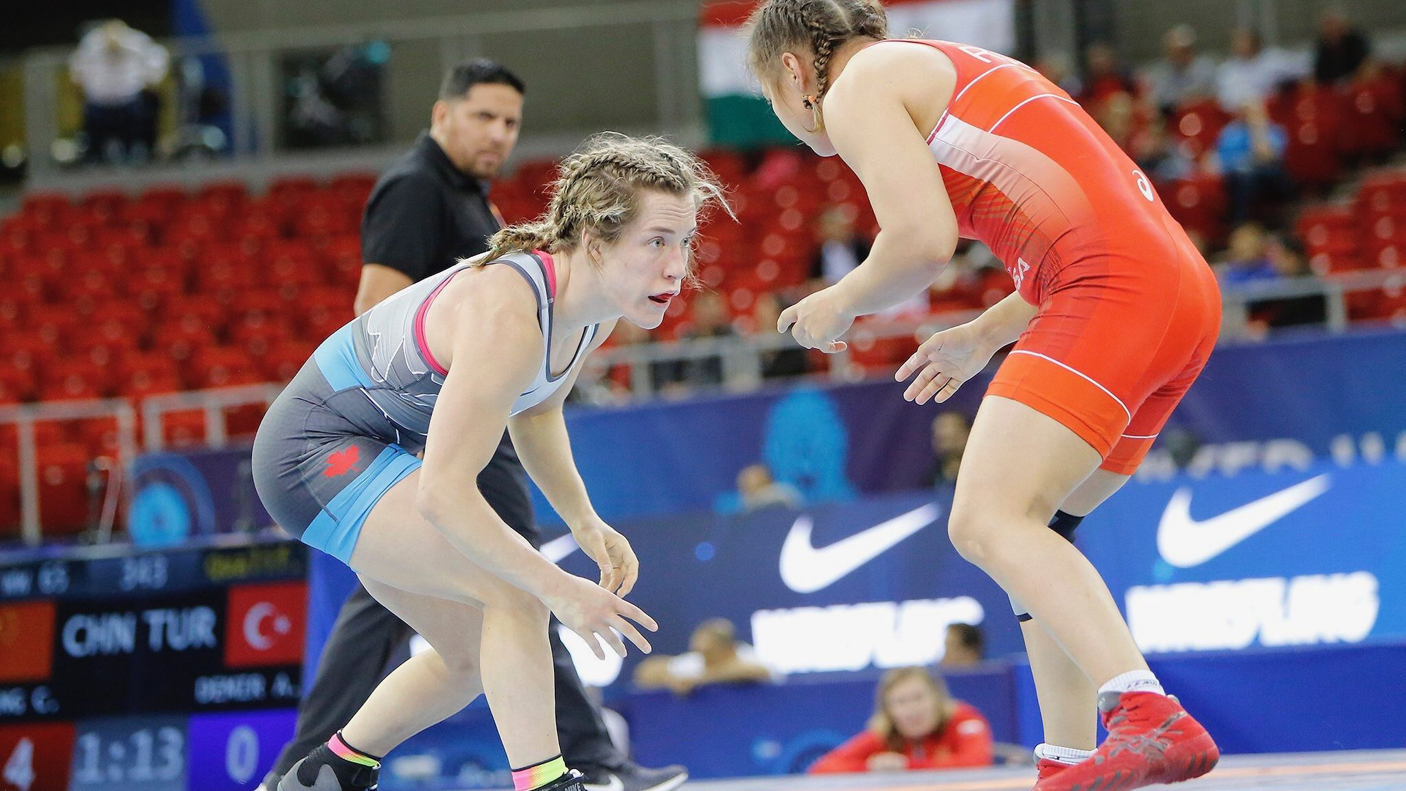Two women wrestlers about to start a match